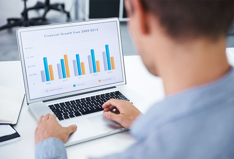 Photo showing financial growth on a laptop